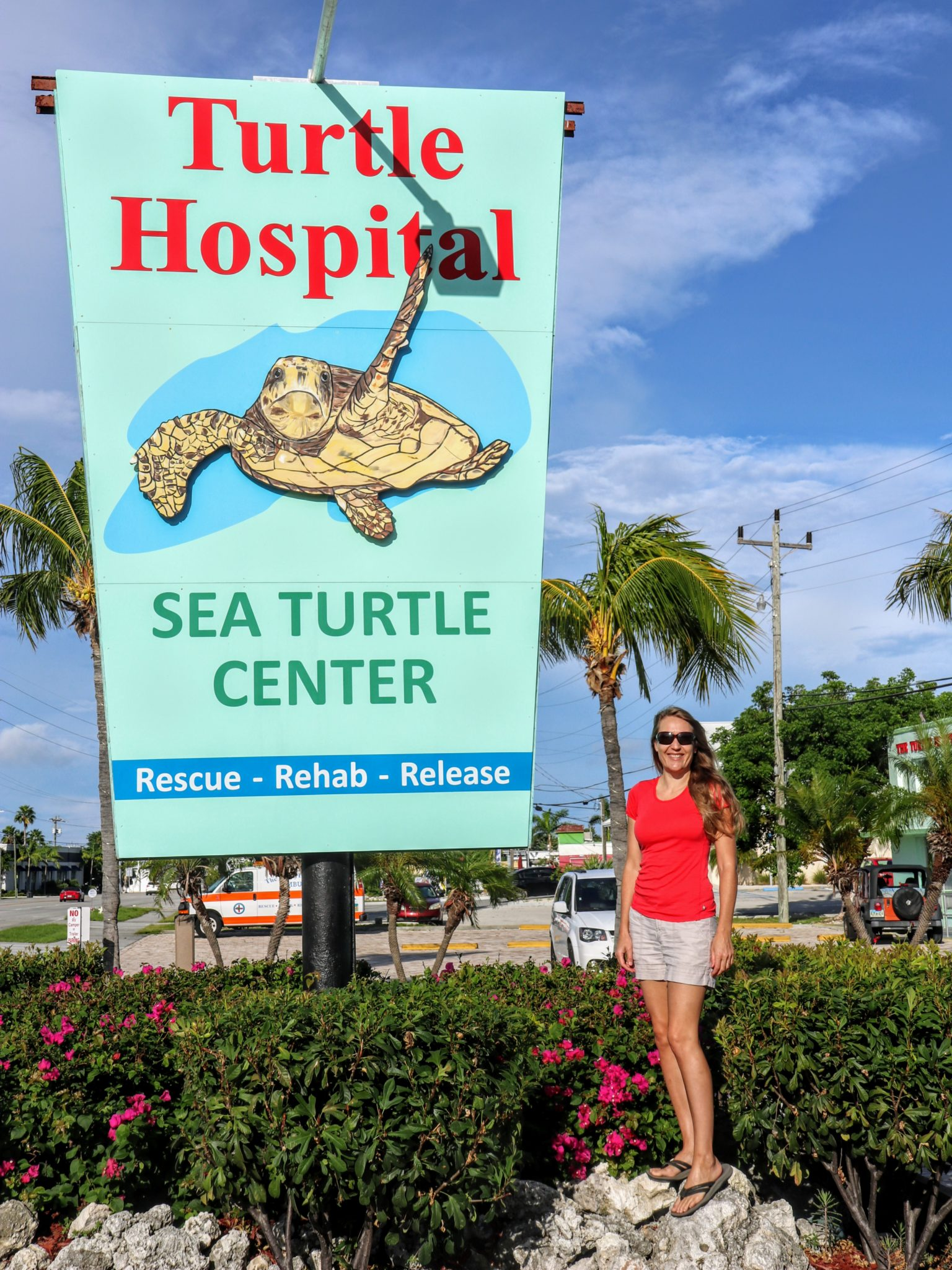 The author of this article standing next to the Turtle Hospital sign.