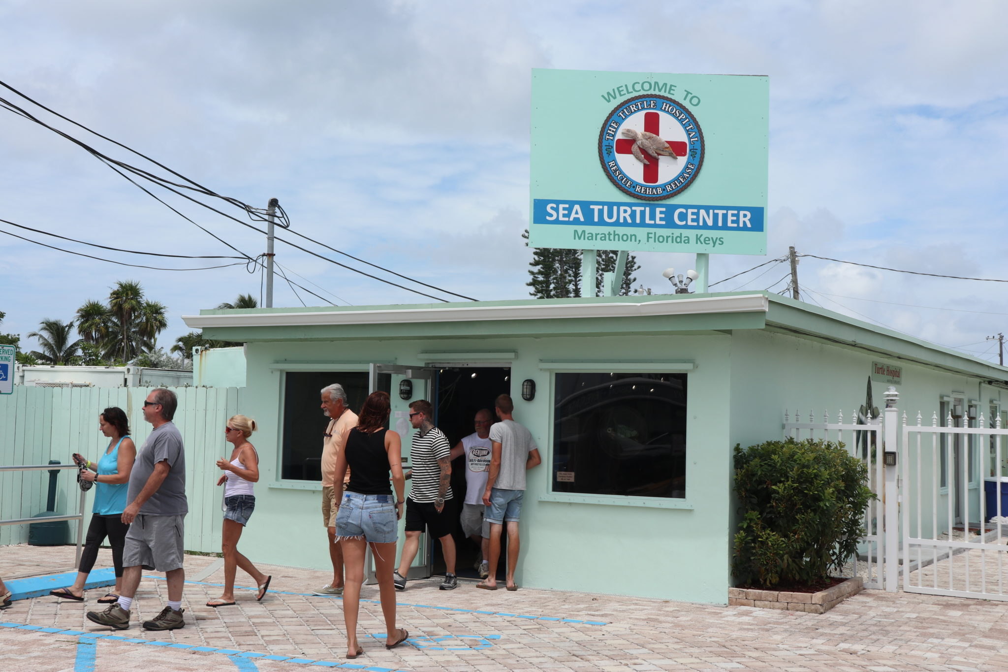 Visitors entering the Turtle Hospital's front entry.