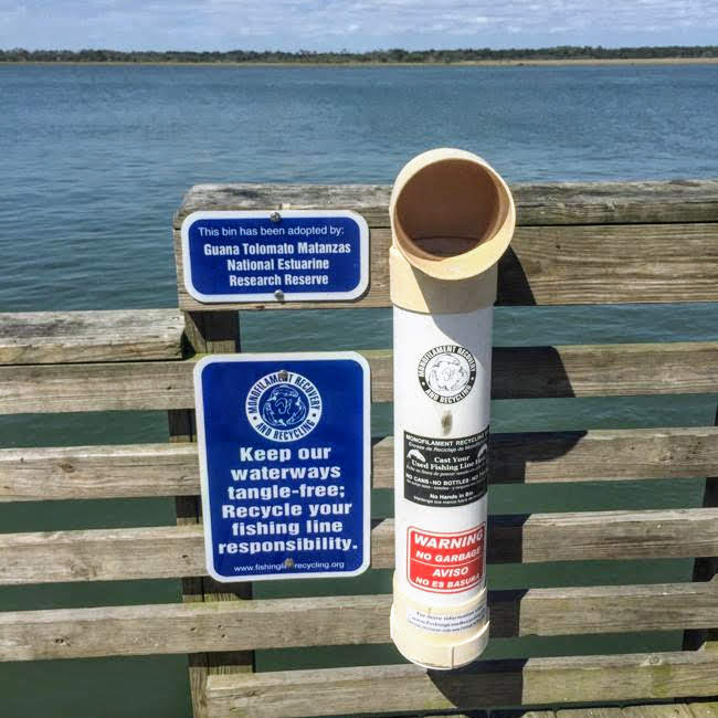 Microfilament and fishing line recycling bin near a Florida waterway.